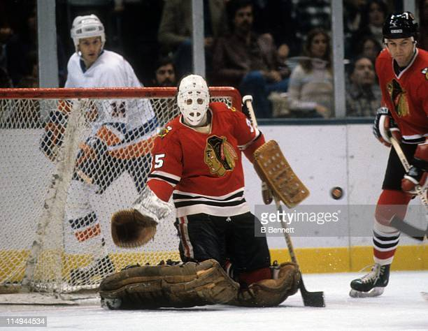 Goalie Tony Esposito of the Chicago Blackhawks makes the save during an NHL game against the New York Islanders circa 1982 at the Nassau Coliseum in...