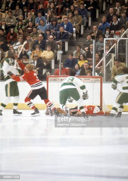 Goalie Tony Esposito of the Chicago Blackhawks makes the save on Dean Prentice of the Minnesota North Stars on March 5 1972 at the Met Center in...