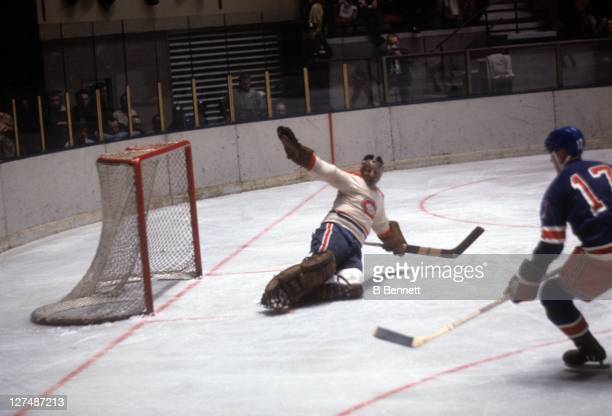 Goalie Tony Esposito of the Montreal Canadiens makes the save during an NHL game against the New York Rangers circa 1968 at the Madison Square Garden...