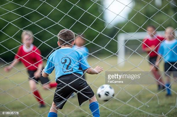 goalie trying to block the ball - fat goalkeeper stock pictures, royalty-free photos & images