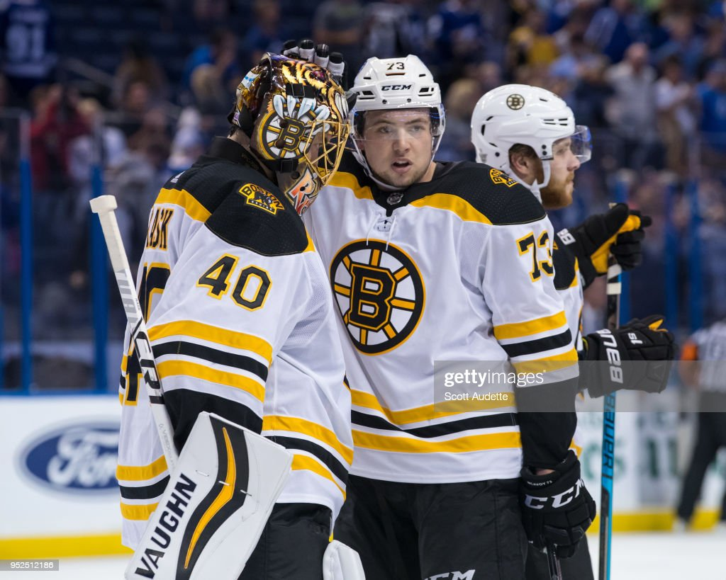 Goalie Tuukka Rask #40 and Charlie McAvoy #73 of the Boston Bruins celebrate the win after Game One of the Eastern Conference Second Round during the 2018 NHL Stanley Cup Playoffs at Amalie Arena on April 28, 2018 in Tampa, Florida.
