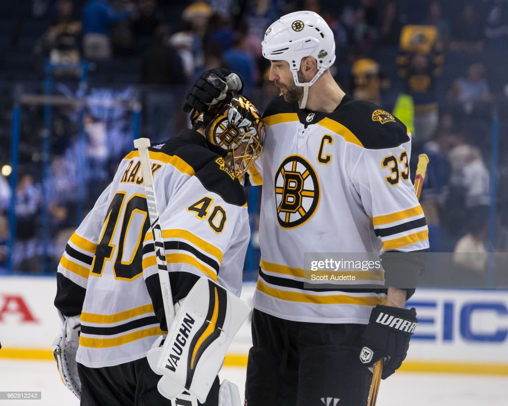 Goalie Tuukka Rask #40 and Zdeno Chara #33 of the Boston Bruins celebrate the win after Game One of the Eastern Conference Second Round during the 2018 NHL Stanley Cup Playoffs at Amalie Arena on April 28, 2018 in Tampa, Florida.