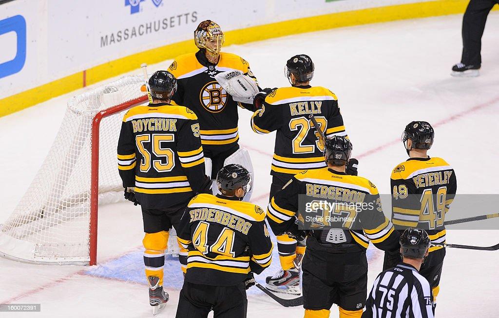 Goalie Tuukka Rask #40 of the Boston Bruins celebrates a win against the New York Islanders at the TD Garden on January 25, 2013 in Boston, Massachusetts.