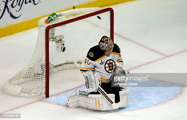 Goalie Tuukka Rask of the Boston Bruins gives up a goal in the second period against Brandon Saad of the Chicago Blackhawks in Game One of the 2013...