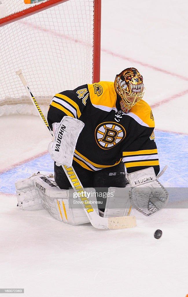 Goalie Tuukka Rask #40 of the Boston Bruins makes a stop against the New York Islanders at the TD Garden on January 25, 2013 in Boston, Massachusetts.