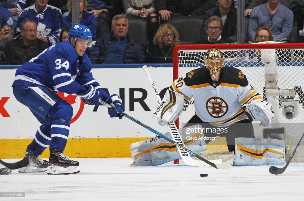 Goalie Tuukka Rask #40 of the Boston Bruins watches a puck being handled by Auston Matthews #34 of the Toronto Maple Leafs in Game Three of the Eastern Conference First Round during the 2018 Stanley Cup Play-offs at the Air Canada Centre on April 16, 2018 in Toronto, Ontario, Canada. The Maple Leafs defeated the Bruins 4-2.