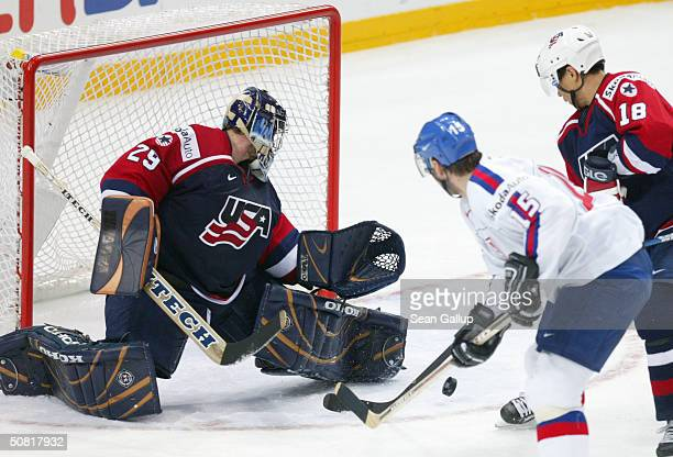 Goalie Ty Conklin and forward Richard Park of the USA stop an attack on goal by Jozef Stumpel of Slovakia in the teams' bronze medal match at the...