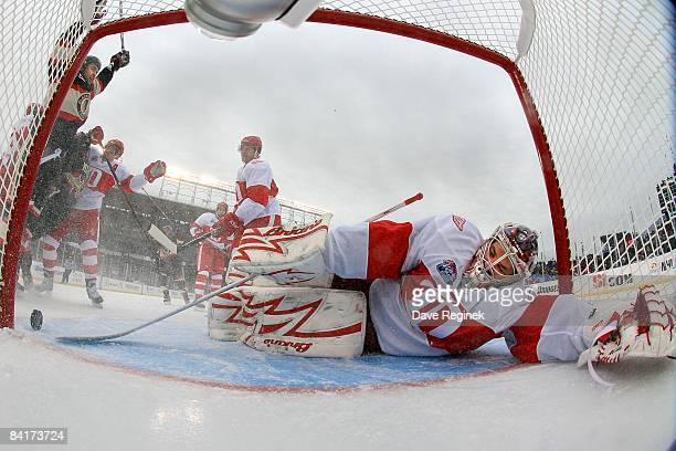 Goalie Ty Conklin of the Detroit Red Wings is scored on by Versteeg of the Chicago Blackhawks while teammate Dustin Byfuglien raises his hands in...