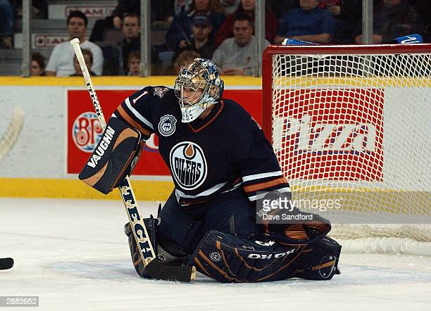 Goalie Ty Conklin of the Edmonton Oilers in net during the game against the Chicago Blackhawks at the Skyreach Centre on November 18 2003 in Edmonton...