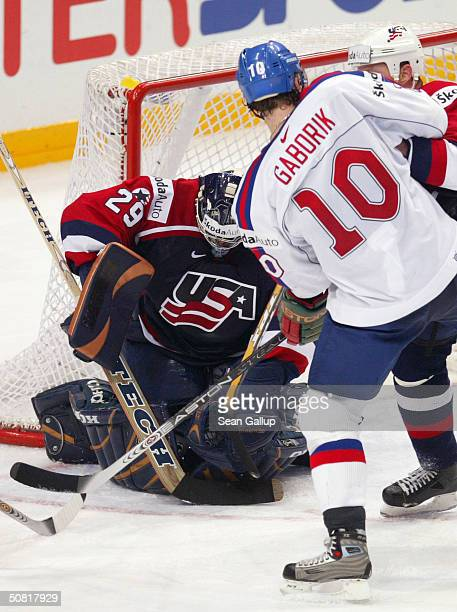 Goalie Ty Conklin of the USA makes a save against Marian Gaborik of Slovakia in the teams' bronze medal match at the International Ice Hockey...