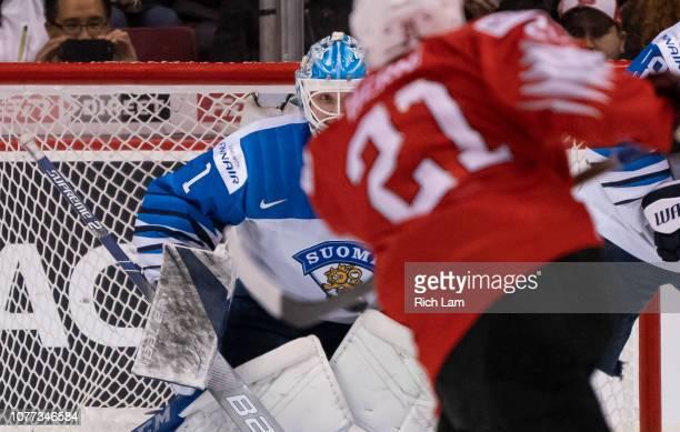 Goalie UkkoPekka Luukkonen of Finland makes a save against Tim Berni of Switzerland in Semifinals hockey action of the 2019 IIHF World Junior...