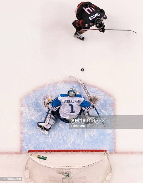 Goalie Ukko-Pekka Luukkonen of Finland stops Maxime Comtois of Canada penalty shot attempt during overtime in Quarterfinal hockey action of the 2019...