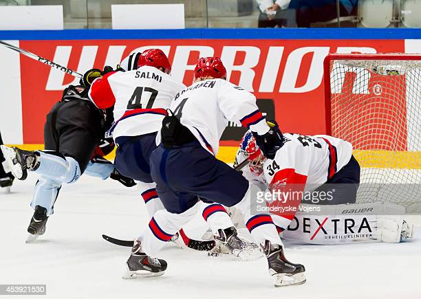 Goalie Villo Husso of IFK Helsinki saves under pressure during the Champions Hockey League group stage game between Sonderjyske Vojens and IFK...