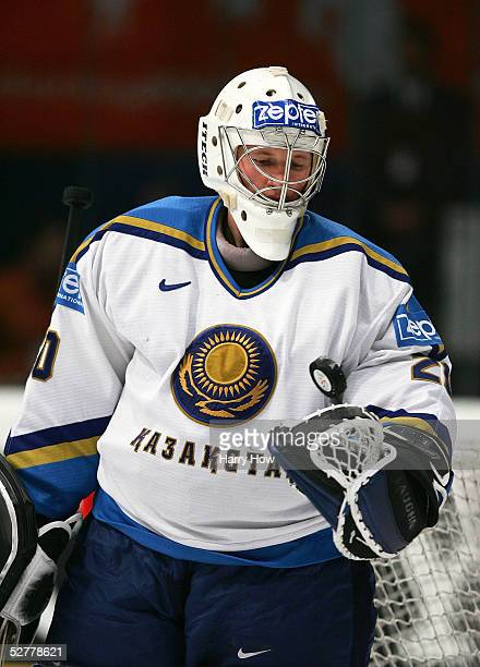 Goalie Vitaliy Kolesnik of Kazakhstan tosses the puck into the air to get it out of his glove after making a save against Russia in the IIHF World...