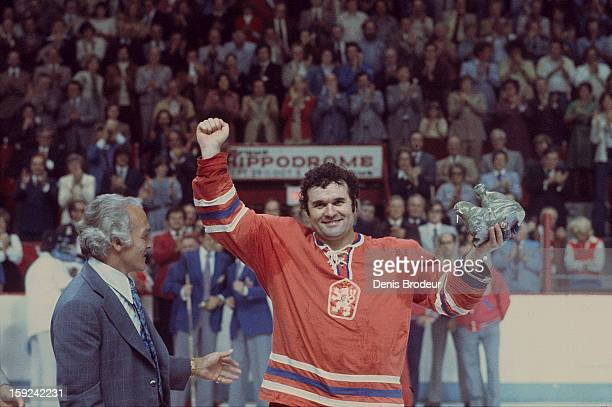 Goalie Vladimir Dzurilla team Czechoslovakia accepts an award from Henri Richard after the Canada Cup Final game held at the Montreal Forum on...