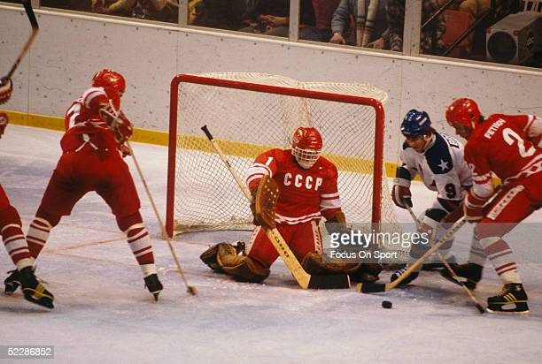 Goalie Vladimir Myshkin and Viacheslav Fetisov of the Soviet Union defend the net as Neal Broten of Team USA goes for the puck during the XIII...