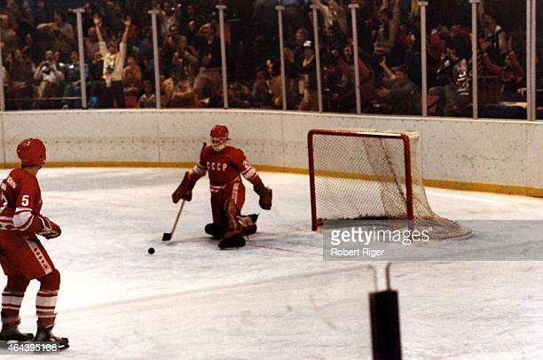 Goalie Vladislav Tretiak of the Soviet Union gives up a goal during the first period of the 1980 Winter Olympic Games against the United States on...