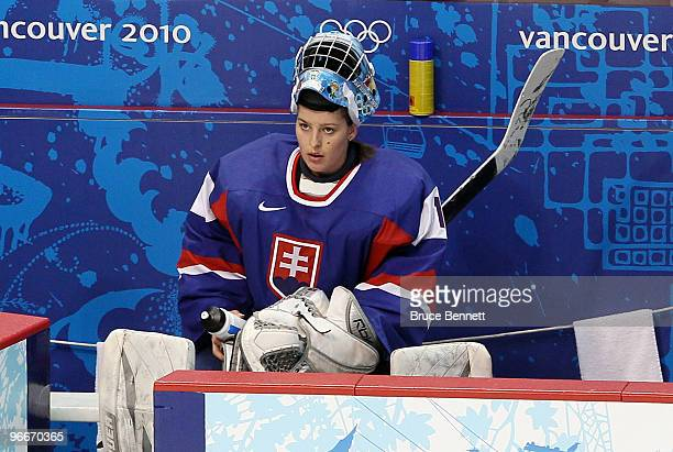 Goalie Zuzana Moravcikova of Slovakia rests at the end of the first period againts Canada where she allowed 7 goals during their women's ice hockey...