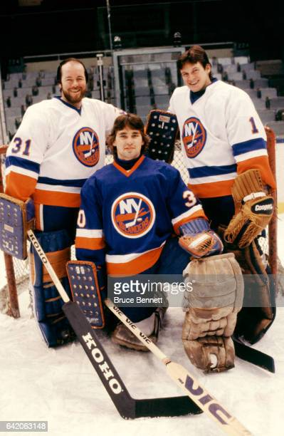 Goalies Billy Smith Kelly Hrudey and Roland Melanson of the New York Islanders pose for a portrait circa December 1983 at the Nassau Coliseum in...