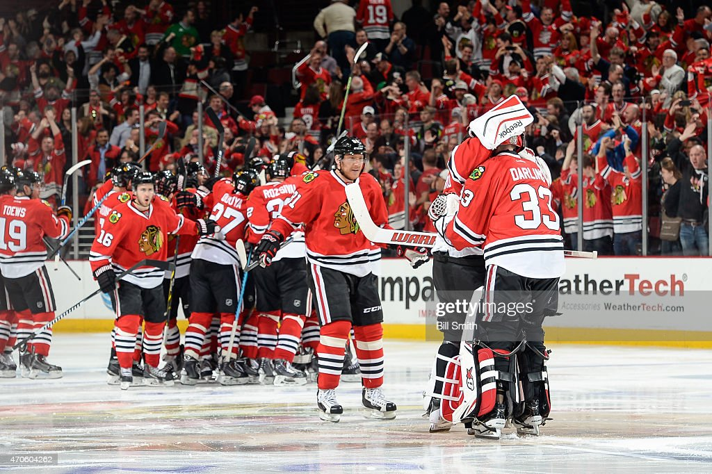 Goalies Corey Crawford #50 and Scott Darling #33 of the Chicago Blackhawks hug after defeating the Nashville Predators 3-2 in triple overtime, in which Darling blocked 50 of the 52 shots on goal during Game Four of the Western Conference Quarterfinals during the 2015 NHL Stanley Cup Playoffs at the United Center on April 21, 2015 in Chicago, Illinois.