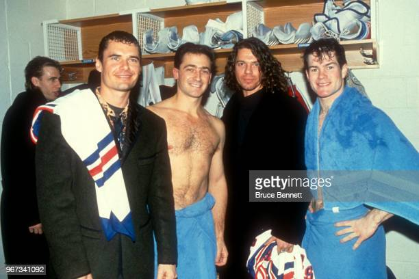 Goalies John Vanbiesbrouck and Mike Richter of the New York Rangers pose with Jon Farriss and Michael Hutchence of the music group INXS after an NHL...