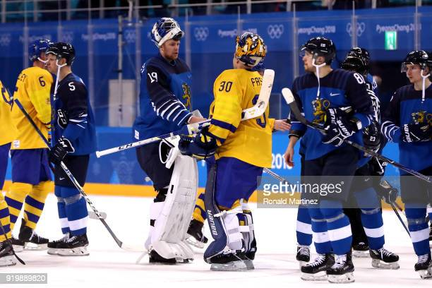 Goalies Mikko Koskinen of Finland and Viktor Fasth of Sweden shake hands after the Men's Ice Hockey Preliminary Round Group C game on day nine of the...