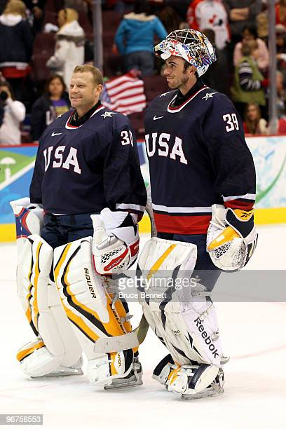 Goalies Tim Thomas and Ryan Miller of the United States skate off the ice after team USA won 3-1 against Switzerland during the ice hockey men's...