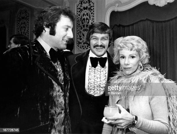 Goalies Tony Esposito of the West and Chicago Blackhawks and Bernie Parent of the West and Philadelphia Flyers talk with comedienne Joan Rivers...