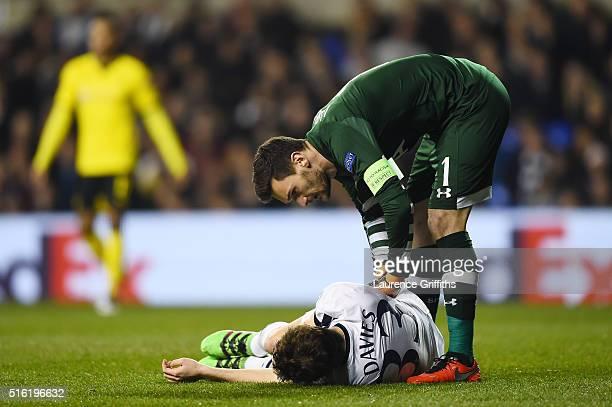 Goalkaaper Hugo Lloris of Tottenham Hotspur checks on Ben Davies of Tottenham Hotspur as he is injured during the UEFA Europa League round of 16...