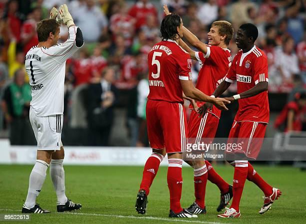 Goalkeaper Michael Rensing, Daniel van Buyten, Holger Badstuber and Saer Sene of Muenchen react after winning the Audi Cup tournament final match...