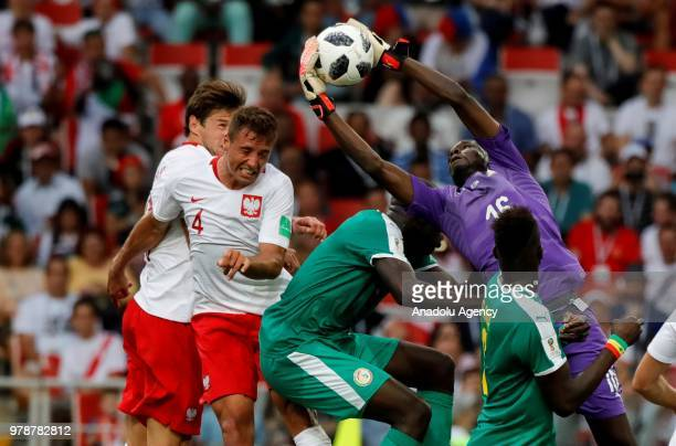 Goalkeeper Abdoulaye Diallo of Senegal in action against Thaigo Cionek of Poland during the 2018 FIFA World Cup Russia Group H match between Poland...