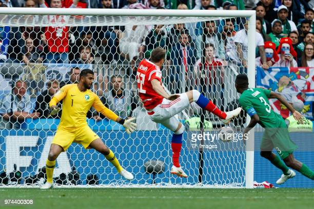 Goalkeeper Abdullah AlMuaiouf of Saudi Arabia in action and Artem Dzyuba of Russia scores the team`s third goal during the 2018 FIFA World Cup Russia...