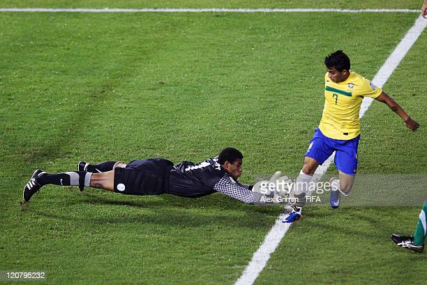 Goalkeeper Abdullah Alsdairy of Saudi Arabia makes a save against Dudu of Brazil during the FIFA U20 World Cup 2011 round of 16 match between Brazil...