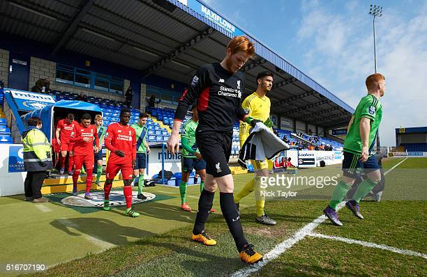Goalkeeper Adam Bogdan of Liverpool makes his way onto the pitch alongside his counterpart in the Southampton goal Paulo Gazzaniga for the start of...