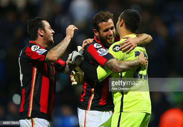 Goalkeeper Adam Federici of Bournemouth celebrates with team mates Lee Tomlin and Steve Cook of Bournemouth as he saves the decisive kick in the...