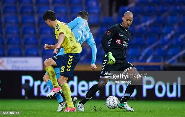 Goalkeeper Adam Kwarasey of Brondby IF controls the ball during the Danish Cup DBU Pokalen quarterfinal match between Randers FC and Brondby IF at...