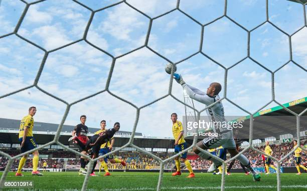 Goalkeeper Adam Kwarasey of Brondby IF saves the ball from Rilwan Hassan of FC Midtjylland during the Danish Alka Superliga match between FC...