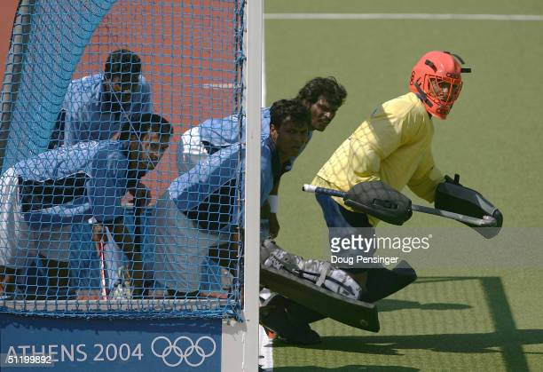 Goalkeeper Adrian D Souza of India leads his team from the goal on a penalty shot as New Zealand defeated India 21 in the men's field hockey...