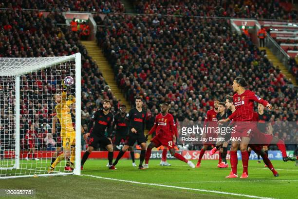 Goalkeeper Adrian of Liverpool saves from Virgil Van Dijk of Liverpool during extra time during the UEFA Champions League round of 16 second leg...