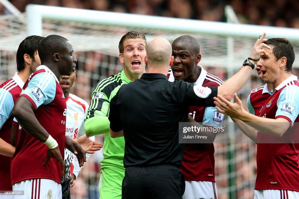 Goalkeeper Adrian of West Ham and teammates remonstrate with referee Anthony Taylor after conceding a penalty for bringing down Jon Flanagan of Liverpool during the Barclays Premier League match between West Ham United and Liverpool at Boleyn Ground on April 6, 2014 in London, England.