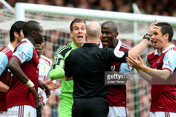 Goalkeeper Adrian of West Ham and teammates remonstrate with referee Anthony Taylor after conceding a penalty for bringing down Jon Flanagan of...