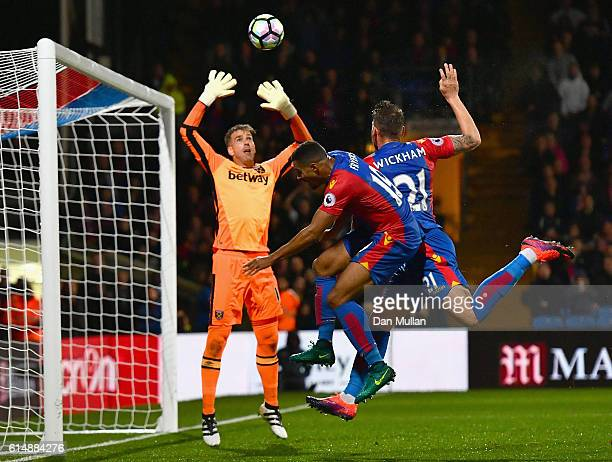 Goalkeeper Adrian of West Ham United foils Zeki Fryers and Connor Wickham of Crystal Palace during the Premier League match between Crystal Palace...