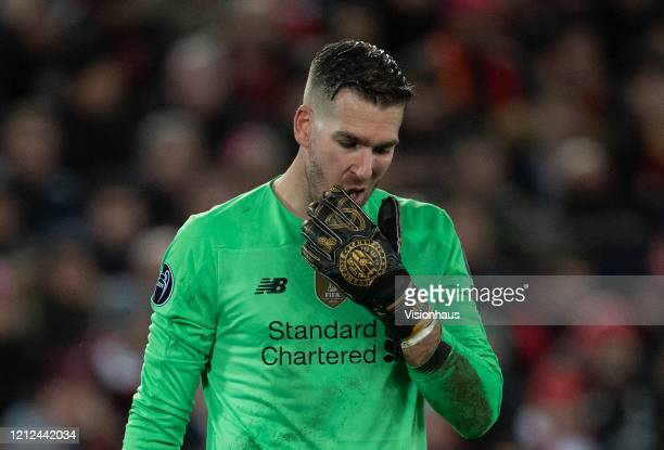 Goalkeeper Adrián of Liverpool reacts after his mistake led to the first Atletico goal during the UEFA Champions League round of 16 second leg match...