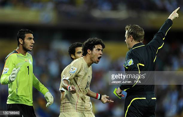 Goalkeeper Ahmed Elshenawi Mohamed Ibrahim and Omar Gaber of Egypt disagree with a decision of referee Markus Strombergsson during the FIFA U20 World...