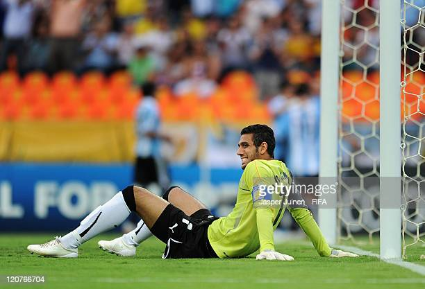 Goalkeeper Ahmed Elshenawi of Egypt sits dejected after conceding a goal during the FIFA U20 World Cup Colombia 2011 round of 16 match between...