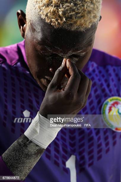 Goalkeeper Al Seyni Ndiaye of Senegal looks dejected after his red card during the FIFA Beach Soccer World Cup Bahamas 2017 group A match between...