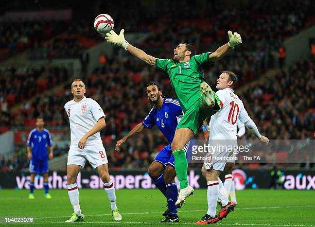 Goalkeeper Aldo Junior Simoncini of San Marino fails to claim the ball during the FIFA 2014 World Cup Group H qualifying match between England and...
