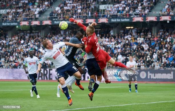 Goalkeeper Aleksandar Jovanovic of AGF Aarhus and Dame N'Doye of FC Copenhagen compete for the ball during the Danish Superliga match between AGF...