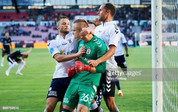 Goalkeeper Aleksandar Jovanovic of AGF Aarhus saves a penalty and celebrate with Casper Hojer Nielsen and Niklas Backman of AGF Aarhus during the...
