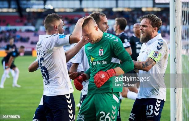 Goalkeeper Aleksandar Jovanovic of AGF Aarhus saves a penalty and celebrate with Casper Hojer Nielsen Niklas Backman and Pierre Kanstrup of AGF...